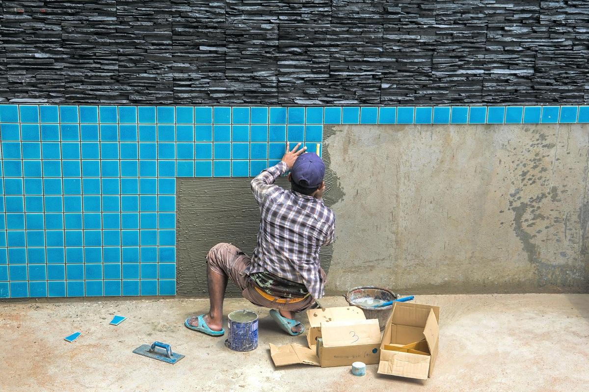 man constructing pool