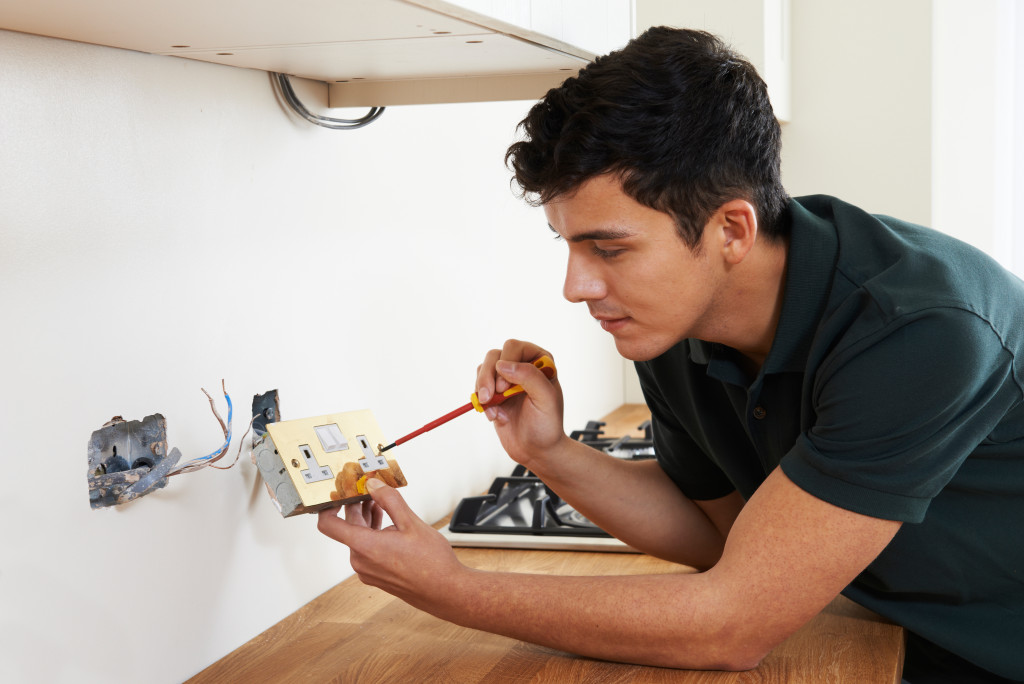 man fixing outlet
