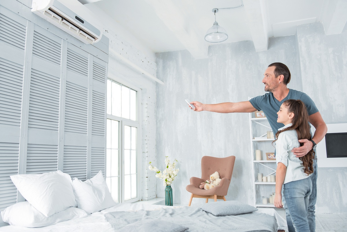 man and daughter using aircon
