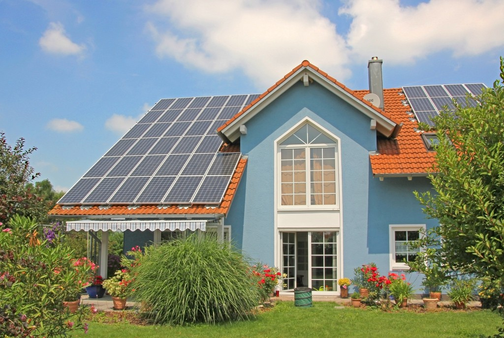 home exterior with solar panel roofing