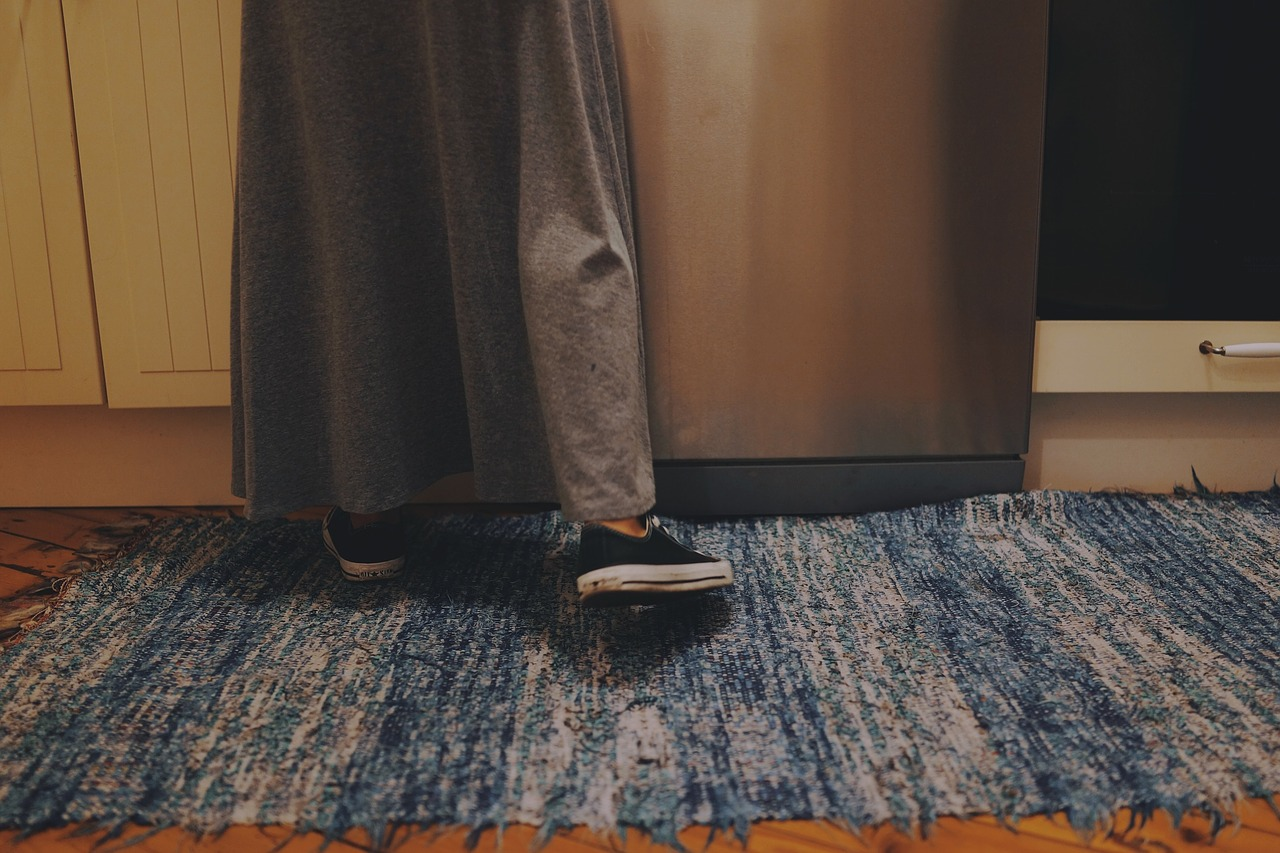 person stepping on a rug