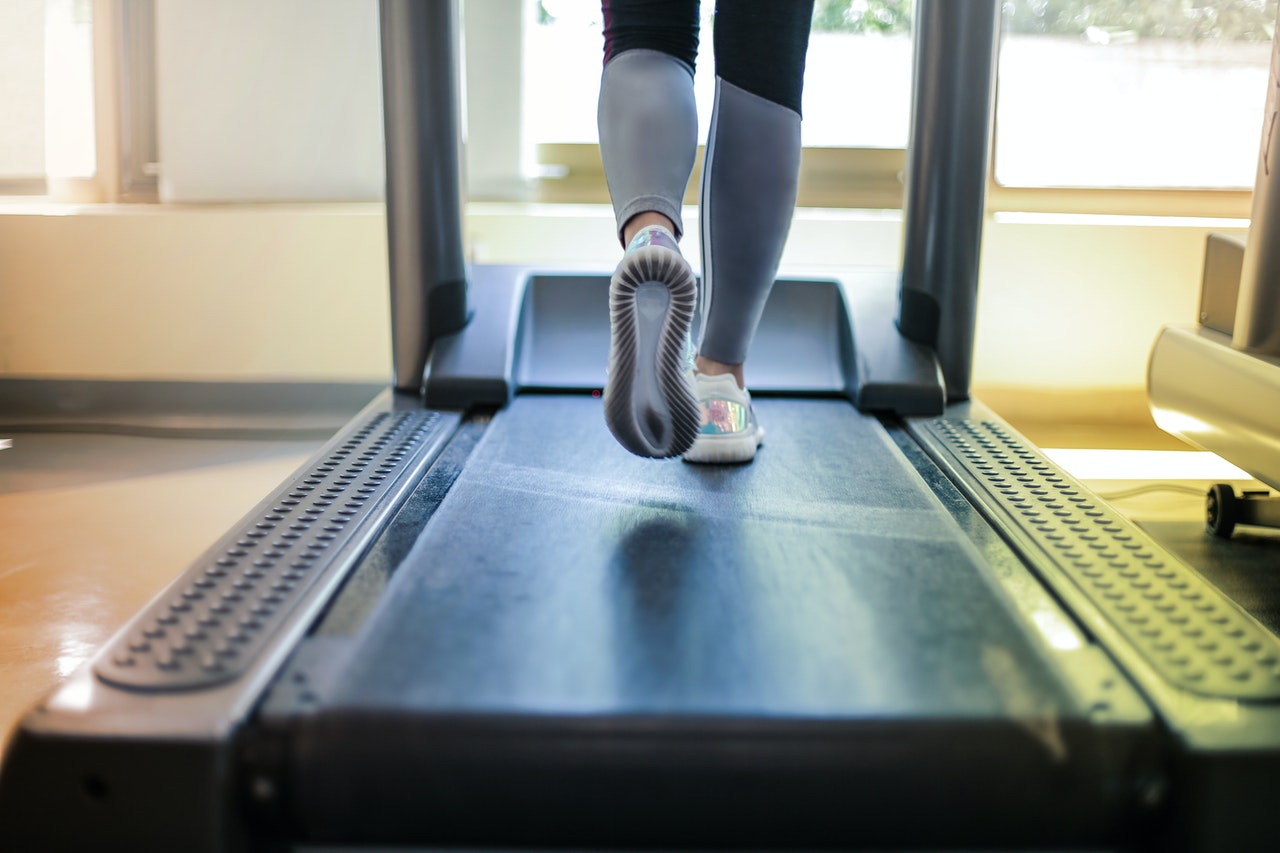 person walking on treadmill