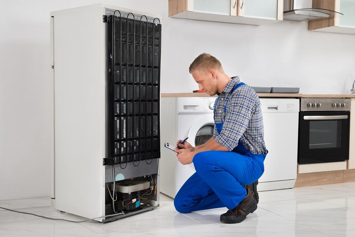 man fixing the refrigerator
