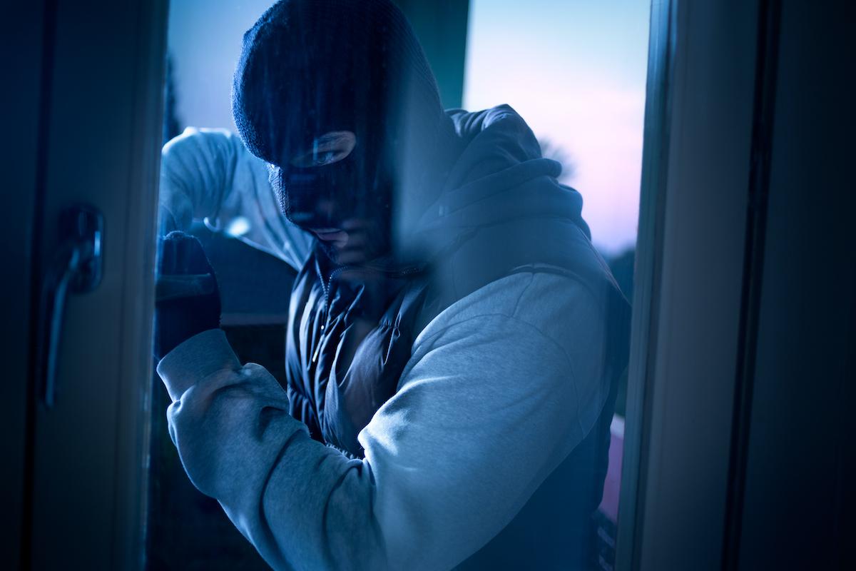 robber attempting to break in