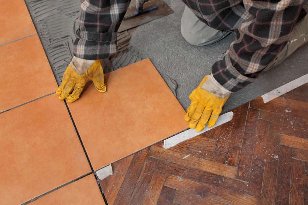 man laying tiles