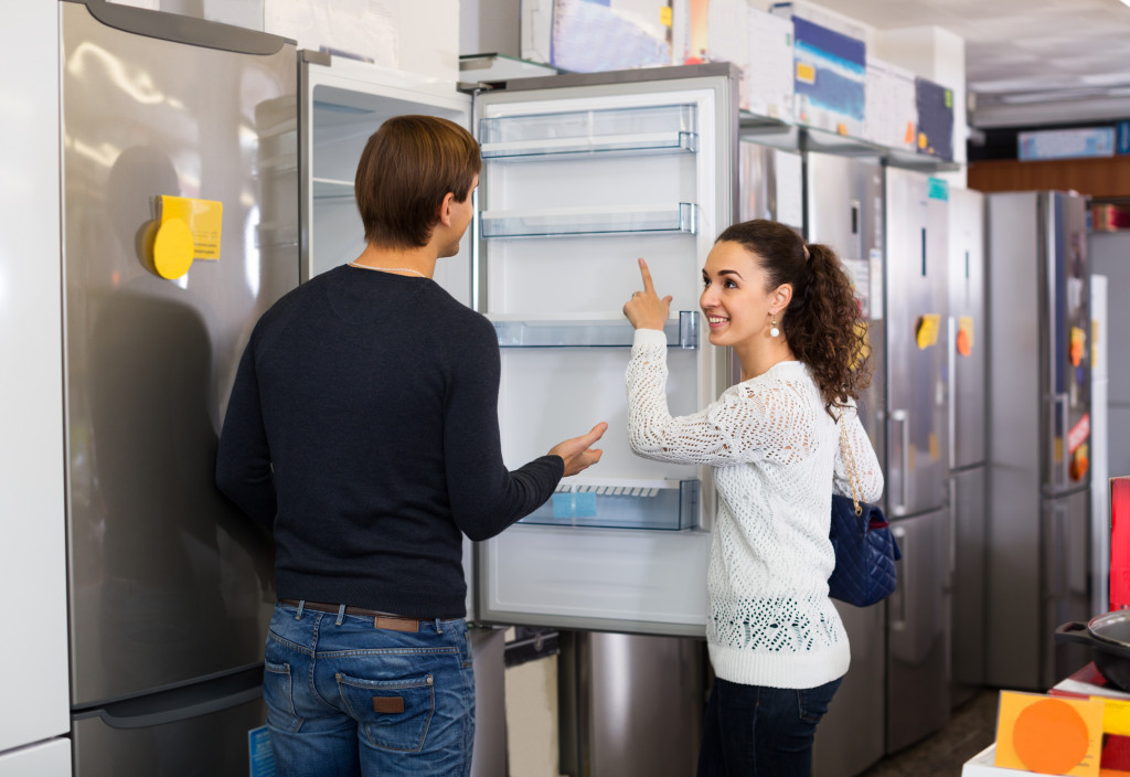 couple shopping for a refrigerator